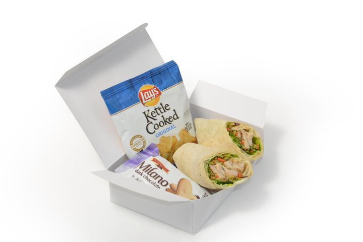 What could be in that wrap sandwich box? Milano cookies and Lay's potato chips.