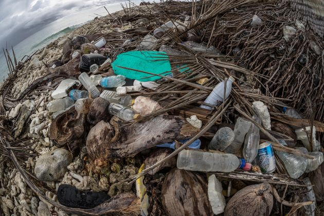 Plastic waste is seen washed ashore in the Truk Lagoon,