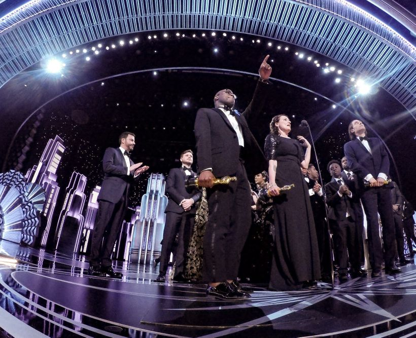 After the debacle: Adele Romanski, Berry Jenkins, and Jeremy Kleiner accept the Oscar for Best motion picture of the year, fo