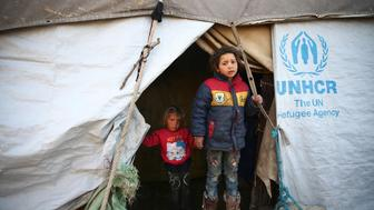 Internally displaced children stand at the entrance to their tent, in the eastern Damascus suburb of Ghouta, Syria February 9, 2017. REUTERS/Bassam Khabieh     TPX IMAGES OF THE DAY