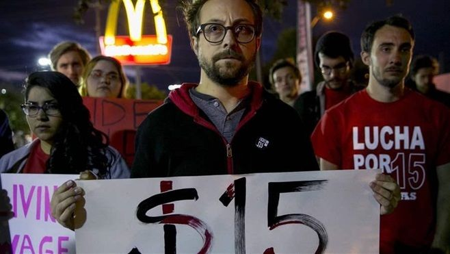 A demonstration in support of striking fast-food workers at a McDonald's restaurant in Austin, Texas. The parent companies of