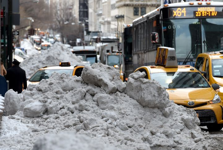 A giant pile of snow is seen on March 15, 2017 in New York City the morning after a massivesnow storm whipped through&n