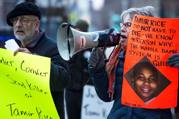 Protesters gather outside of City Hall to protest the death of 12-year old Tamir Rice in Cleveland, Ohio, on November 26. Ric