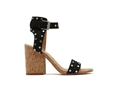 "Edgy nail heads and a chunky cork heel give a slightly punk-twist to your look.<br><br><a href=""https://www.dolcevita.com/pro"