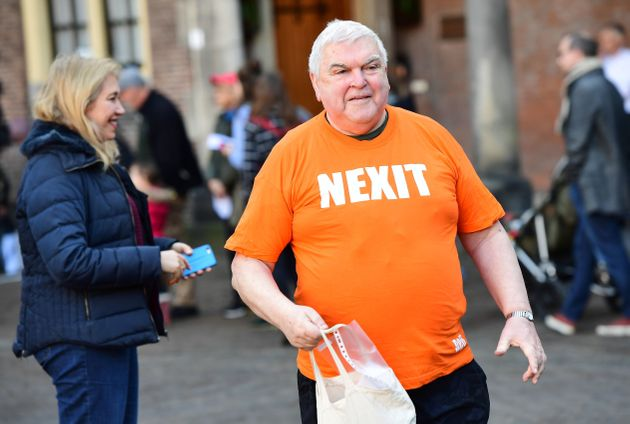 A man wearing a tee-shirt reading 'Nexit' (refering to the so-called 'Nexit' or the Dutch withdrawal...