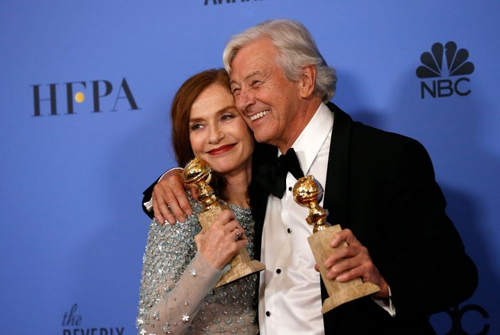 "Isabelle Huppert and ""Elle"" director Paul Verhoeven backstage at the Golden Globes on Jan. 8, 2017."