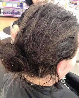 The woman's hair when she first entered the