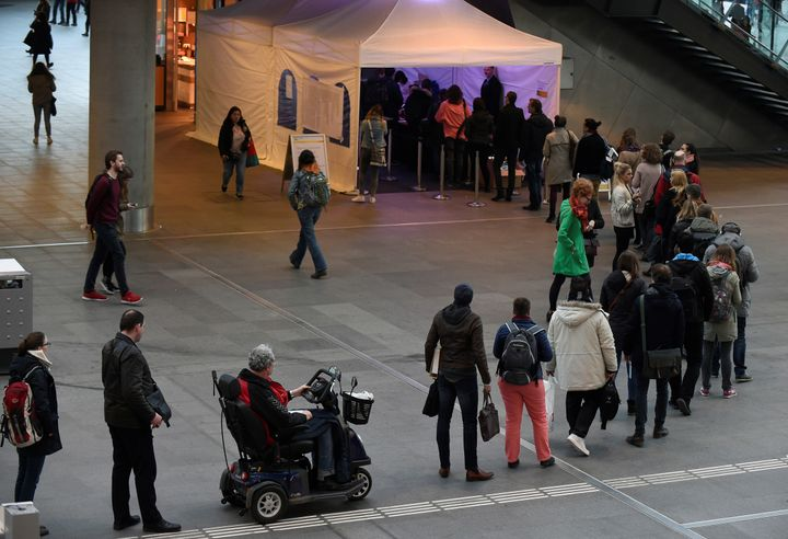 People queue to cast their vote for the general elections in The Hague.