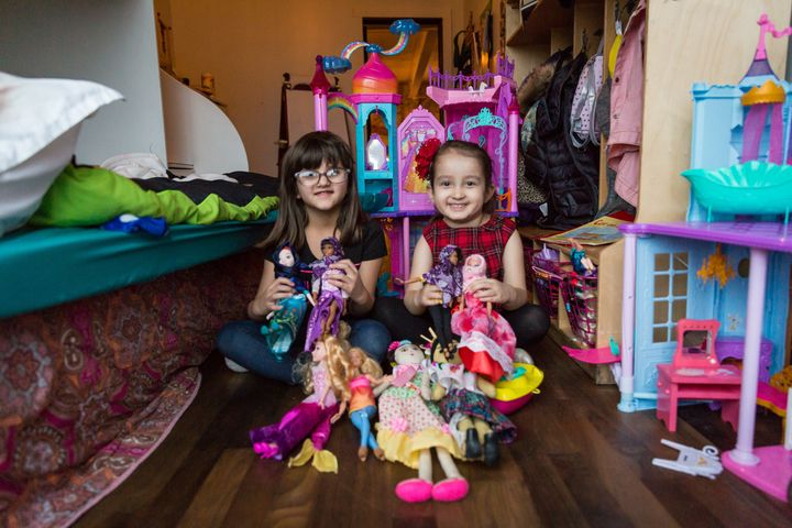 Grace Fetterman (left) and Salma Bokhari play together with dolls.