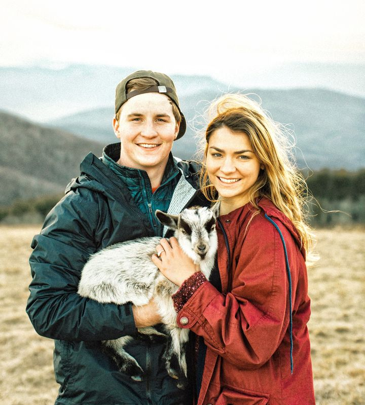 Andrew and Allison with their baby goatMax.
