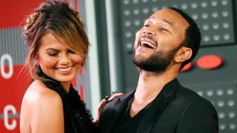 Model Chrissy Teigen and her husband, musician John Legend, arrive at the 2015 MTV Video Music Awards in Los Angeles, California August 30, 2015.   REUTERS/Danny Moloshok