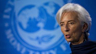 Christine Lagarde, managing director of the International Monetary Fund (IMF), delivers a statement at the IMF headquarters in Washington, D.C., U.S., on Monday, Dec. 19, 2016. The IMF's executive board reiterated its backing for Lagarde, indicating support for her to remain managing director of the lender despite being convicted of negligence by a French court. Photographer: Andrew Harrer/Bloomberg via Getty Images
