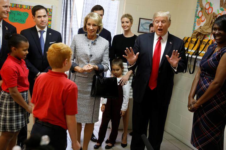 President Donald Trump, joined by Florida Gov. Rick Scott (R), Sen. Marco Rubio (R-Fla.), Education Secretary Betsy DeVos, da