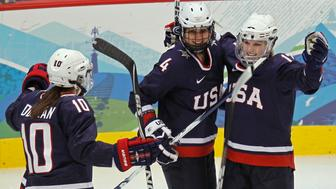 Angela Ruggiero (4) of the U.S. celebrates with Meghan Duggan (10) and Jocelyne Lamoureux (17) after she scored the third goal against Sweden in the second period of their women's ice hockey play-offs semifinals game at the Vancouver 2010 Winter Olympics February 22, 2010.     REUTERS/Shaun Best (CANADA)
