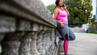 Plus size women jogging and exercising at the park and walking outdoor in the city streets in Chicago, United States - USA. Weight loss concept