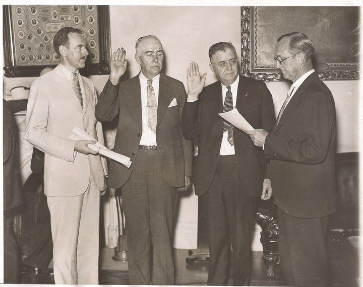 W. W. Durbin (third from left) being sworn-in. Dean Acheson as witness (far left). 1934