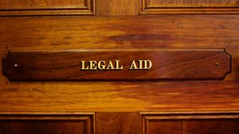 Legal aid sign on a door in an old courthouse, Bathurst, Australia.