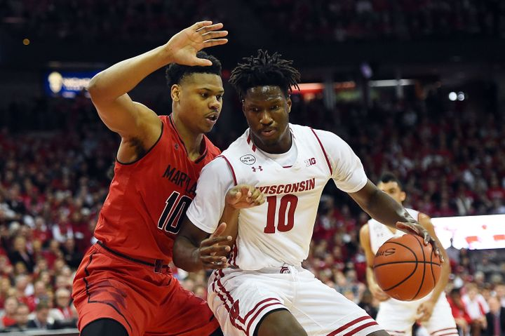 Wisconsin forward Nigel Hayes (right) is among the current and former college athletes who have sued the NCAA over compensati