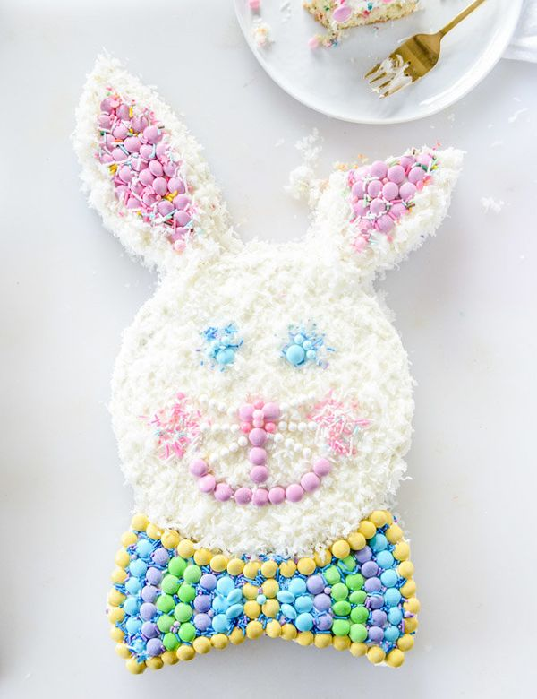 """<strong>Get the <a href=""""http://www.howsweeteats.com/2016/03/confetti-coconut-classic-bunny-cake-with-mms/"""" target=""""_blank"""">C"""