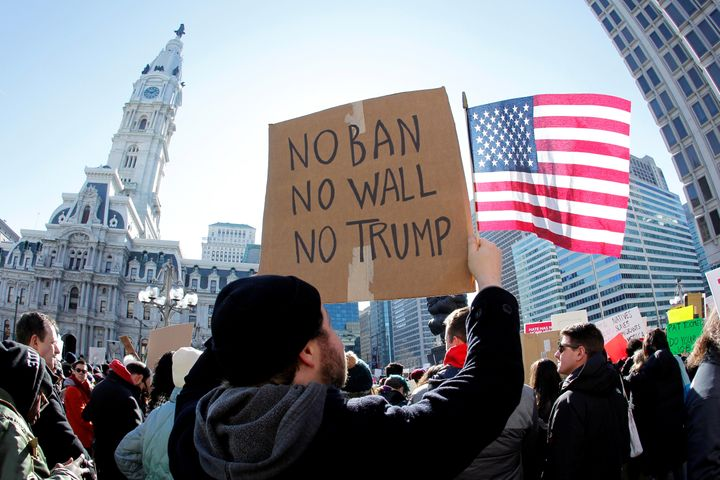 Protesters rally in Philadelphia against President Donald Trump's initial executive order barring refugees and cert