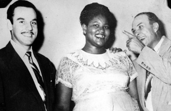 "CIRCA 1950: Band leader Johnny Otis poses for a portrait with ""Big Mama"" Willie Mae Thornton and Peacock Records executive Do"