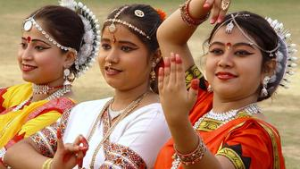 Indian girls perform a dance in celebration of International Women's Day in Agartala, the capital of the northeastern Indian state of Tripura, March 8, 2005. Around the globe, preparations are underway to celebrate International Women's Day to proclaim gender equality as a fundamental human right. REUTERS/Jayanta Dey  VM/SD/MK