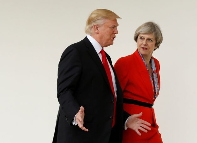 US President Donald Trump escorts British Prime Minister Theresa May after their meeting at the White...