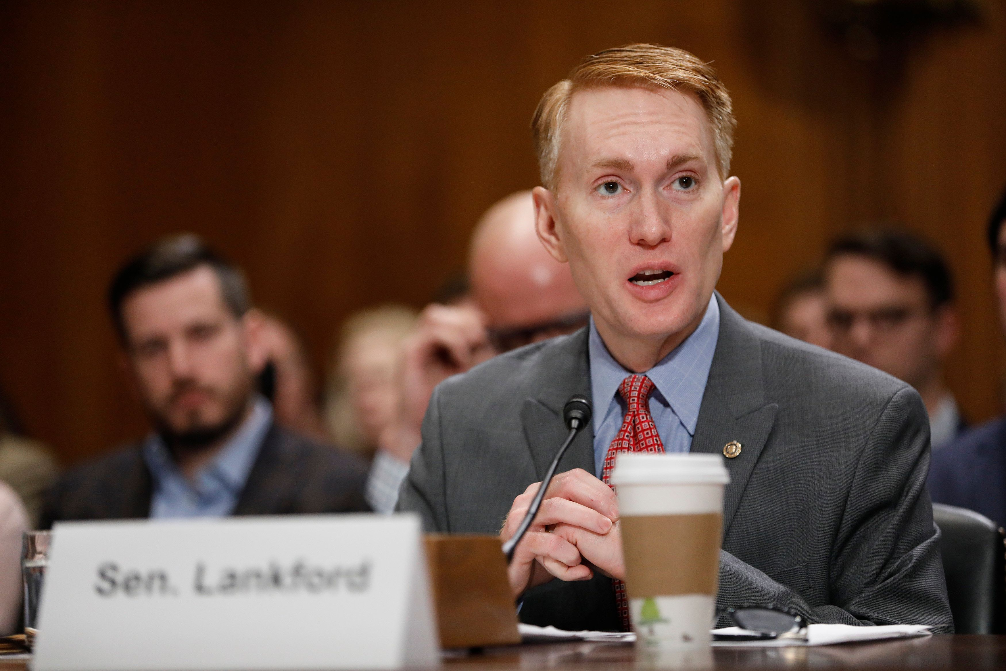 WASHINGTON, DC - JANUARY 18: Sen. James Lankford (R-OK) introduces Oklahoma Attorney General Scott Pruitt, President-elect Donald Trump's choice to head the Environmental Protection Agency, prior to his confirmation hearing before the Senate Committee on Environment and Public Works on Capitol Hill January 18, 2017 in Washington, DC. Pruitt is expected to face tough questioning about his stance on climate change and ties to the oil and gas industry.   (Photo by Aaron P. Bernstein/Getty Images)