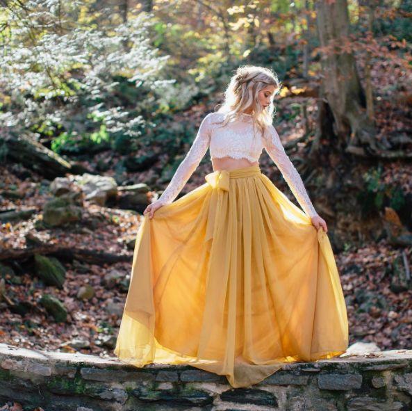 "<i>Dress by <a href=""http://www.sweetcarolinestyles.com/"" target=""_blank"">Sweet Caroline Styles</a></i>"