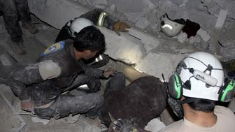 ALEPPO, SYRIA - MARCH 16: Civil defense team members and people try to rescue people who were trapped under the debris of a Mosque after an aerial attack on a mosque during prayer in the Cina village of Etarib district of Aleppo, Syria on March 16, 2017. 58 civilians killed in the attack.  (Photo by Ibrahim Ebu Leys/Anadolu Agency/Getty Images)