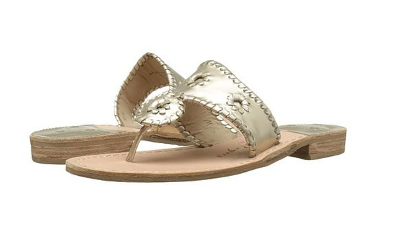 """The chic, slip-on sandals have real, whip-stitched leather and a stacked wooden heel. Every shoe is handmade.<a href=""""h"""