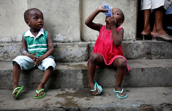 "A child drinks water in central Lagos. Around <a href=""http://www.who.int/gho/child_health/mortality/mortality_causes_text/en"