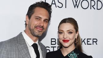 HOLLYWOOD, CA - MARCH 01:  Actor Thomas Sadoski (L) and actress Amanda Seyfried arrive at the premiere of Bleecker Street Media's 'The Last Word' at ArcLight Hollywood on March 1, 2017 in Hollywood, California.  (Photo by Amanda Edwards/Getty Images )