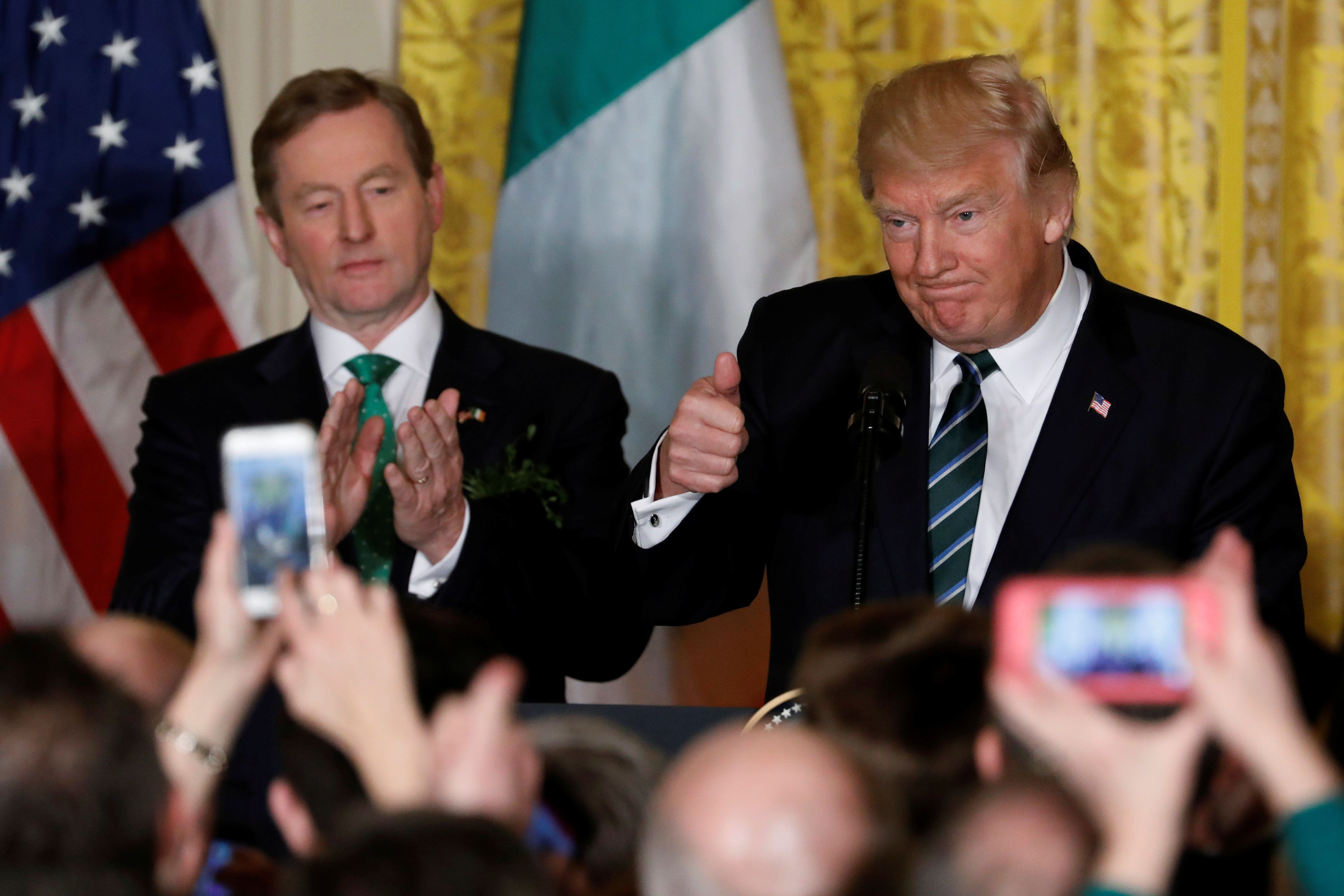 U.S. President Donald Trump (R) delivers remarks alongside Ireland's Prime Minister Enda Kenny (L) at a St. Patrick's Day reception at the White House in Washington, U.S. March 16, 2017. REUTERS/Jonathan Ernst