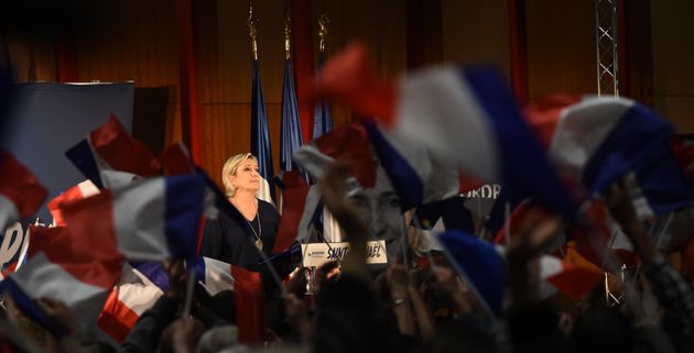 French far-right Front National party candidate Marine Le Pen stands on stage this