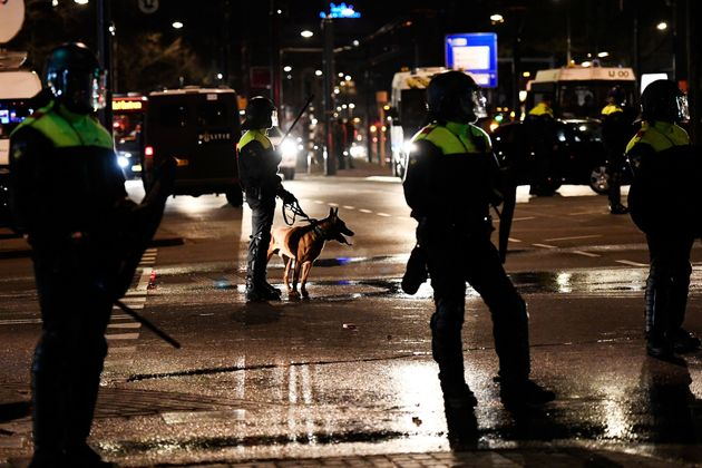 Riot police stand guard during clashes with demonstrators near the Turkish consulate in Rotterdam, Netherlands....