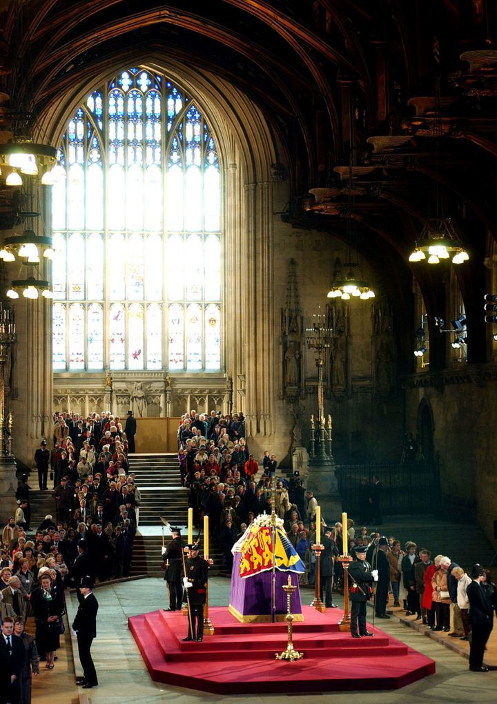 Members of the public file past the coffin of Queen Elizabeth, the Queen Mother as it lies in state in Westminster Hall, April 8, 2002.