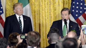 WASHINGTON, DC - MARCH 16: (AFP OUT)  President Donald J. Trump listens as The Taoiseach of Ireland Enda Kenny speaks during a reception in the East Room of the White House on March 16, 2017 in Washington, DC. (Photo by Olivier Douliery-Pool/Getty Images)