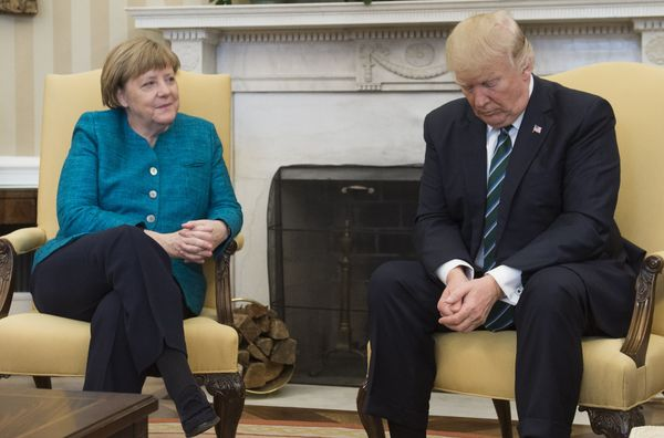 US President Donald Trump and German Chancellor Angela Merkel meet in the Oval Office of the White House in Washington, DC, o