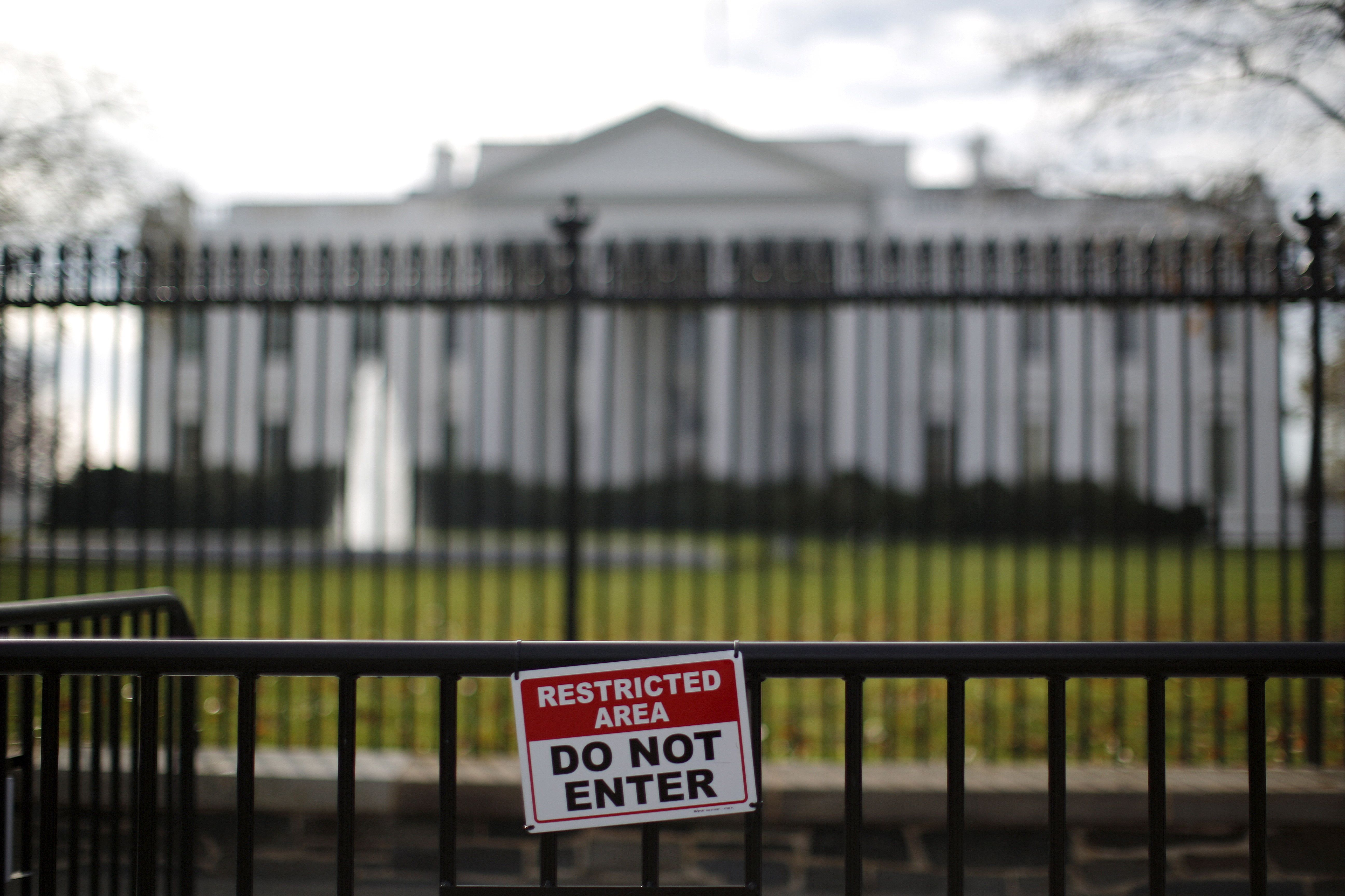 A restricted area sign is seen outside of the White House in Washington November 27, 2015. A man who jumped the White House fence on Thursday, triggering a lockdown of the presidential mansion, was quickly caught and now faces criminal charges, the U.S. Secret Service said. REUTERS/Carlos Barria
