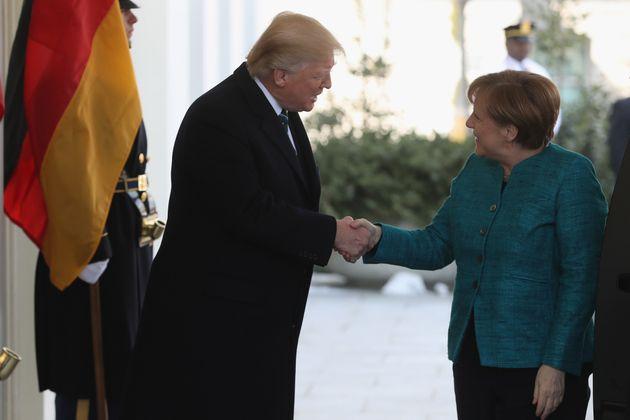Trump and Merkel earlier in the