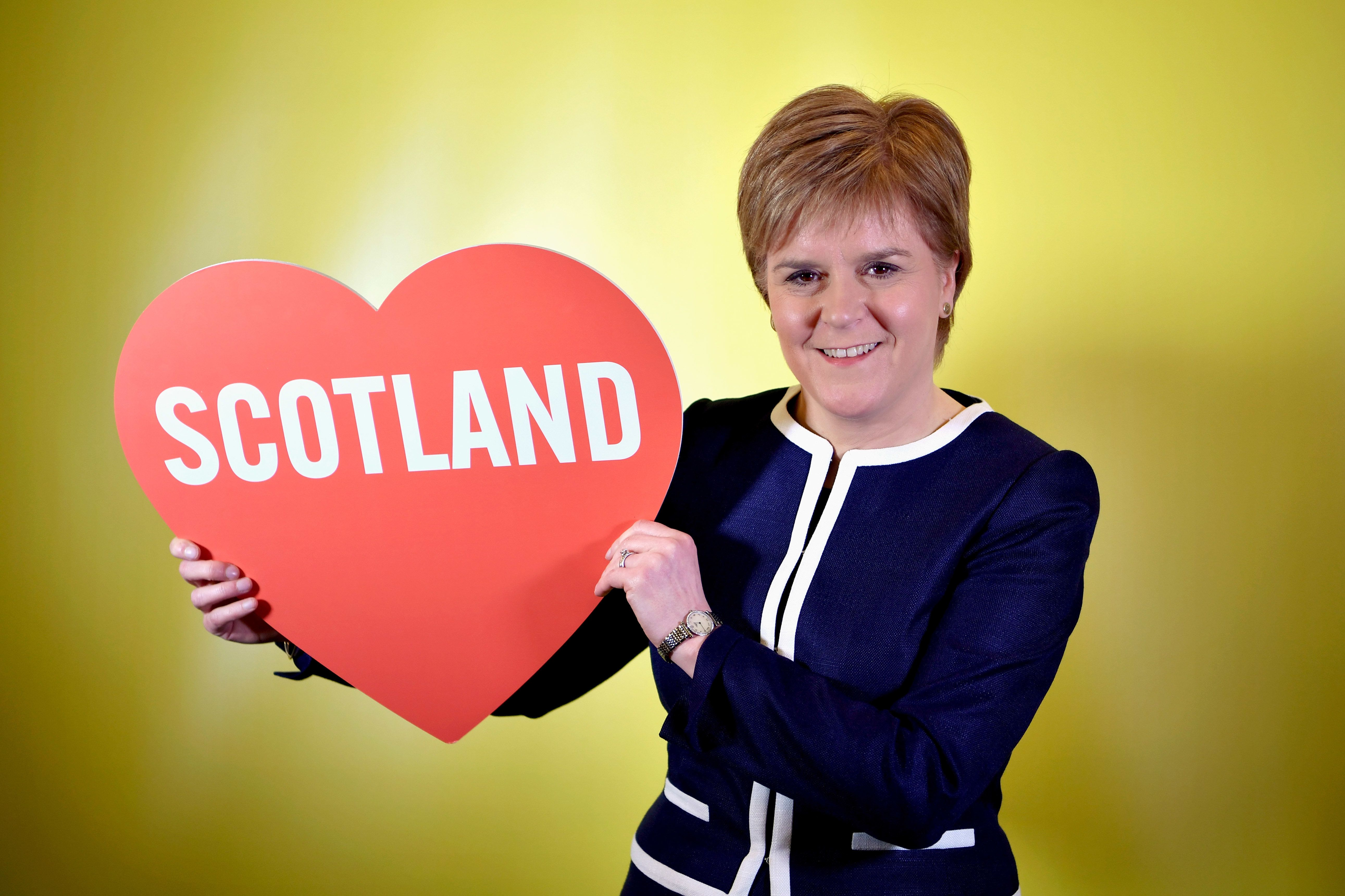 ABERDEEN, SCOTLAND - MARCH 17:  First Minister of Scotland Nicola Sturgeon poses for a photograph with a love heart at the spring conference on March 17, 2017 in Aberdeen, Scotland. Addressing delegates at the spring conference this morning in Aberdeen today, deputy leader Angus Robertson claimed that the Prime Minister Theresa May 'panicked' in turning down calls for a referendum on independence.  (Photo by Jeff J Mitchell/Getty Images)