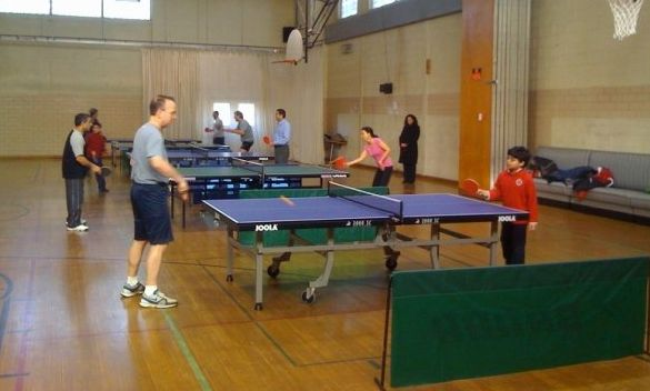 Rumi Khan playing ping pong with Governor Markell in 2010.