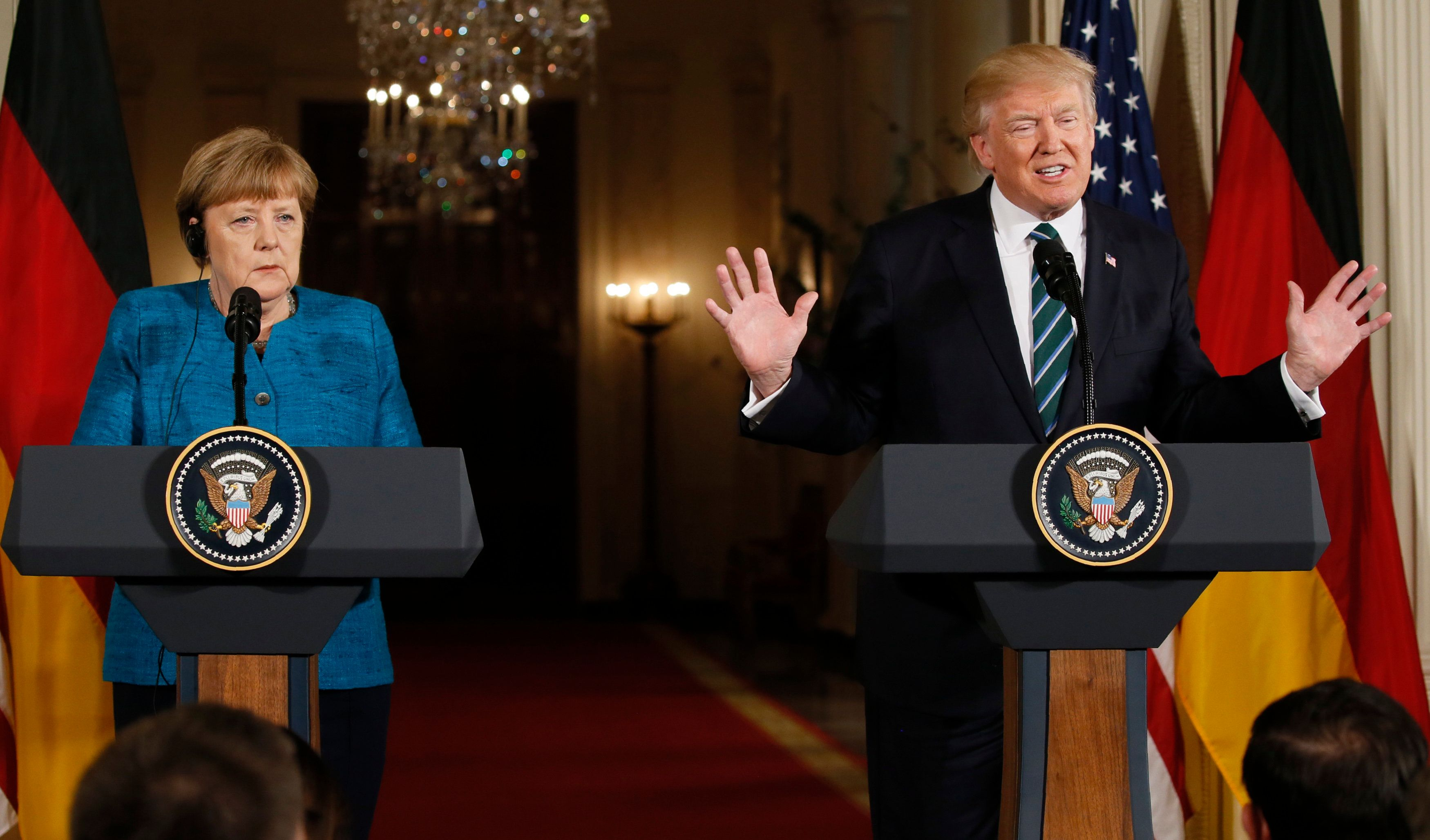 U.S. President Donald Trump speaks as German Chancellor Angela Merkel listens during their joint news conference in the East