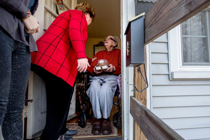Nancy Brennerman, center, makes a Meals on Wheels delivery to Josephine Hayward, 93, of Portland, Maine, on Christmas Day 201