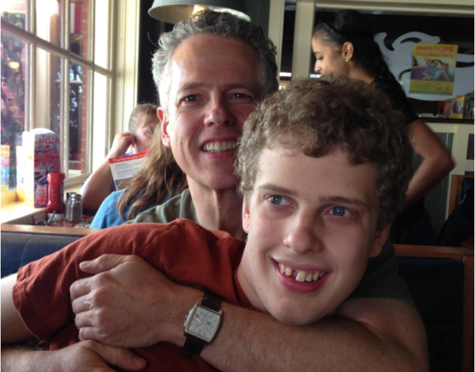 Luke, pictured here with his father Jeff Perkins, was at the center of a disability rights case.