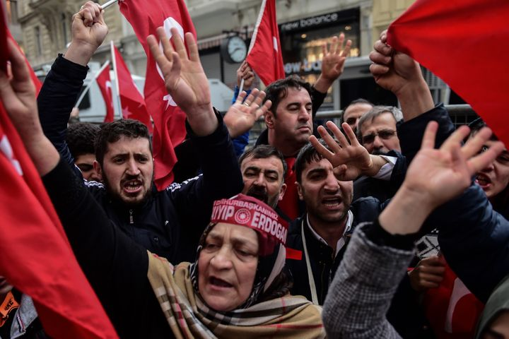 Protesters shout slogans and wave Turkish national flags in front of the Dutch consulate in Istanbul. March 12, 2017.