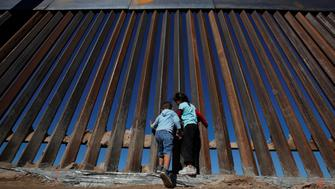 Children play at a newly built section of the U.S.-Mexico border wall at Sunland Park, U.S. opposite the Mexican border city of Ciudad Juarez, Mexico November 18, 2016. Picture taken from the Mexico side of the U.S.-Mexico border. Picture taken November 18, 2016. REUTERS/Jose Luis Gonzalez