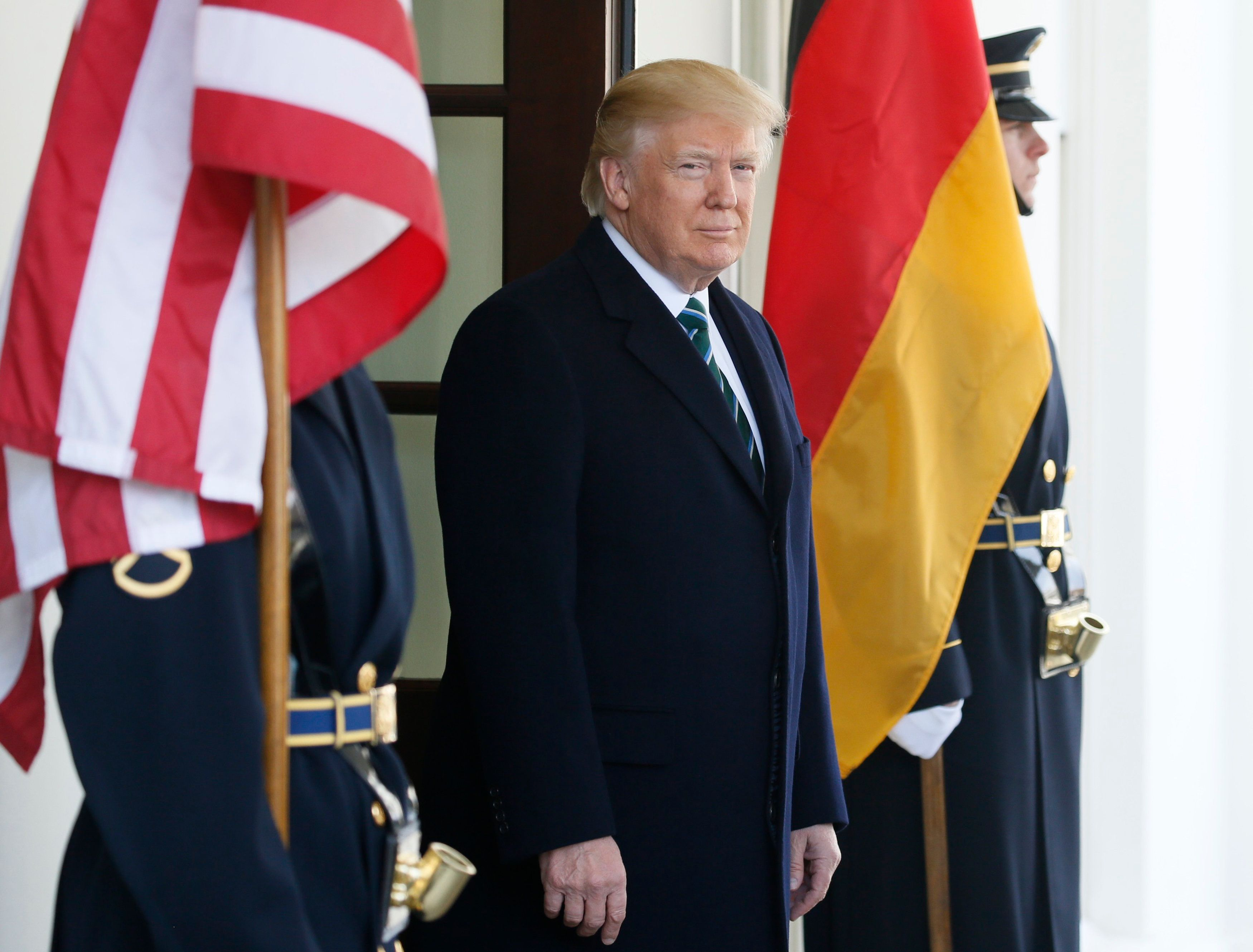 U.S. President Donald Trump awaits the arrival of German Chancellor Angela Merkel at the White House in Washington, U.S., March 17, 2017.   REUTERS/Jim Bourg