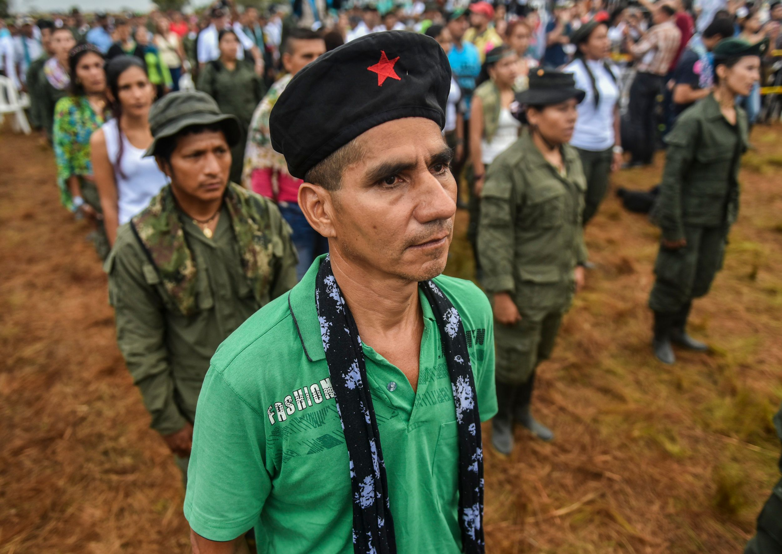 Members of the Revolutionary Armed Forces of Colombia (FARC) attend the opening ceremony of the September 17-23 10th National Guerrilla Conference at the camp in Llanos del Yari, Caqueta department, Colombia, on September 17, 2016. After 52 years of armed conflict, FARC rebels open what leaders hope will be their last conference as a guerrilla army, where they are due to vote on a historic peace deal with the Colombian government. / AFP / LUIS ACOSTA        (Photo credit should read LUIS ACOSTA/AFP/Getty Images)